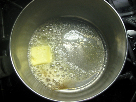 In a small saucepan, melt the butter.
