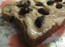Deeply gratifying homemade pumpkin spiced yogurt cream cheese on toast with raisins.